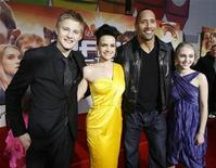 "<p>Cast members (from L-R) Alexander Ludwig, Carla Gugino, Dwayne Johnson and AnnaSophia Robb pose at the premiere of the movie ""Race to Witch Mountain"" at El Capitan theatre in Hollywood, California March 11, 2009. REUTERS/Mario Anzuoni</p>"