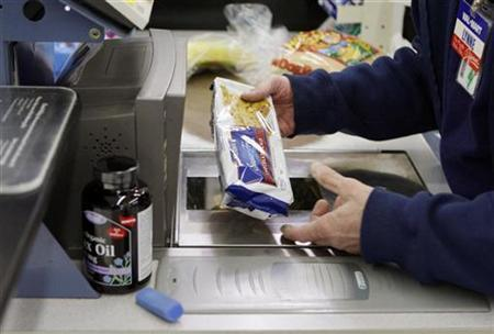 A cashier scans the price of Michael Lipsitz' groceries at the WalMart in Crossville, Tennessee in this March 21, 2008 file photo. REUTERS/Brian Snyder