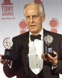 <p>Director Michael Blakemore holds up The American Theatre Wing's 2000 Tony Awards for Best Direction of a Play and for Best Direction of a Musical at the Tony Awards show at New York's Radio City Music Hall, June 4, 2000. REUTERS/Brad Rickerby</p>
