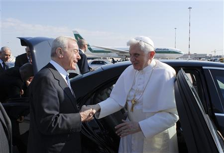 Pope Benedict XVI (R) is greeted by Italian Cabinet Undersecretary Gianni Letta as he arrives at the Fiumicino international airport in Rome March 17, 2009. REUTERS/Osservatore Romano