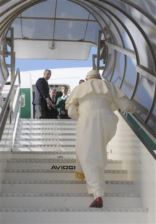 Pope Benedict XVI boards the plane departing for Africa at Fiumicino international airport in Rome March 17, 2009. REUTERS/Osservatore Romano
