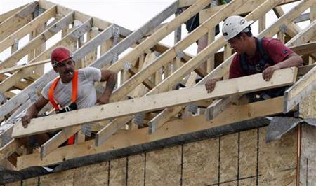 Construction workers frame a house at a new home development in Ottawa July 9, 2008. REUTERS/Chris Wattie