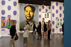 "<p>Visitors look at Mao paintings by U.S. artist Andy Warhol during the exhibition ""Le grand Monde d'Andy Warhol"" (The World of Andy Warhol) at the Grand Palais museum in Paris March 17, 2009. REUTERS/Benoit Tessier</p>"