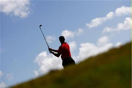 Tiger Woods of the U.S. hits a shot during final round play of the CA Championship at Doral Golf Resort in Miami, Florida March 15, 2009. REUTERS/Carlos Barria