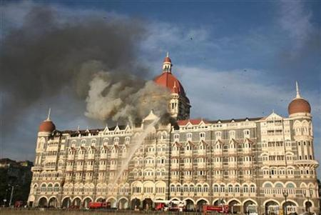 Firefighters try to douse a fire at the Taj Mahal hotel in Mumbai, November 27, 2008. REUTERS/Punit Paranjpe
