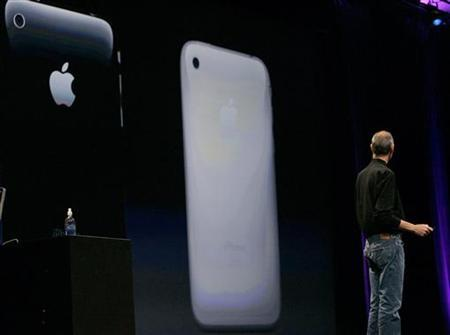 Apple Corporation CEO Steve Jobs looks at a screen showing the new iPhone 3G during his keynote speech at the Apple Worldwide Developers Conference in San Francisco, California June 9, 2008. REUTERS/Kimberly White