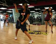 <p>People participate in a Cardio Go Go class at Crunch, Los Angeles in this undated handout photo. REUTERS/Handout</p>