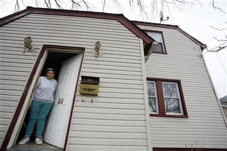 Myrna Millington, 73, stands inside her home that is under foreclosure in New York, March 9, 2009. REUTERS/Shannon Stapleton
