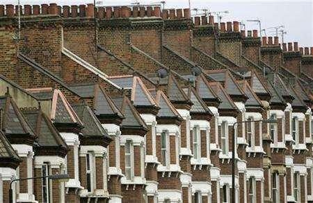 A row of houses is seen along a street in south London May 18, 2007. REUTERS/Toby Melville
