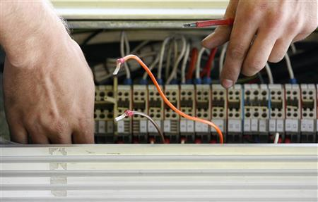 A technician works on network cables in central Sydney April 7, 2009. REUTERS/Daniel Munoz