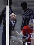 <p>Montreal Canadiens owner George Gillett watches his team play the Atlanta Thrashers in NHL action in Montreal March 24, 2009. REUTERS/Shaun Best</p>
