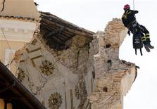 <p>Firefighter Roberto Contu of the Rome's S.A.F team inspects the damaged Duomo church downtown Aquila April 8, 2009. REUTERS/Alessandro Garofalo</p>