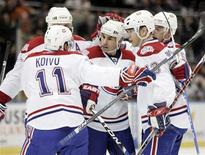 <p>Montreal Canadiens' Mathieu Schneider (3rd L) celebrates his first period goal against the New York Islanders with teammates during NHL hockey action in Uniondale, New York April 2, 2009. REUTERS/Shannon Stapleton</p>