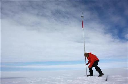 David Vaughan, a glaciologist with the British Antarctic Survey, installs a pole as part of a satellite monitoring system into the Wilkins Ice Shelf off the Antarctic Peninsula on January 18, 2009. REUTERS/Alister Doyle