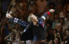 """<p>Chris Martin of Coldplay performs during a concert in Singapore as part of their """"Viva La Vida"""" tour, March 23, 2009. REUTERS/Vivek Prakash</p>"""