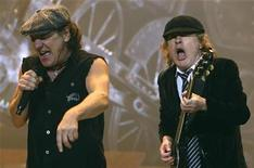 <p>AC/DC lead vocalist Brian Johnson (L) and Angus Young performs at the O2 Millennium Dome stadium in London April 14, 2009. REUTERS/Luke MacGregor</p>
