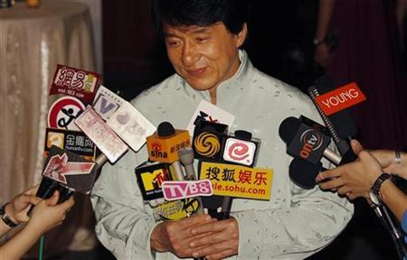 Hong Kong actor Jackie Chan reacts during an interview at the the world premiere of his movie Shinjuku Incident as part of the kickoff for the Hong Kong International Film Festival March 22, 2009. REUTERS/Bobby Yip