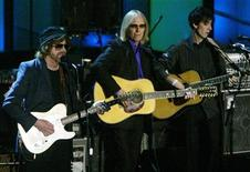 <p>Rock greats Jeff Lynne (L) and Tom Petty play with Dhani Harrison (R), son of ex-Beatle George Harrison, at the 19th Annual Rock and Roll Hall of Fame Induction Ceremony in New York on March 15, 2004. REUTERS/Jeff Christensen</p>