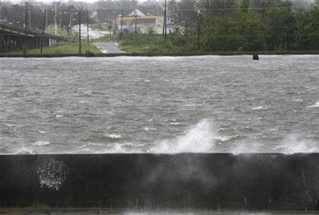 Water splashes over the Inner Harbor Navigational Canal as wind and rain from Hurricane Gustav pounds New Orleans, Louisiana September 1, 2008. REUTERS/Sean Gardner