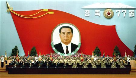 North Korea's nominal No.2 leader and technical head of the state Kim Yong-nam (C, first row) and other officials participate in a ceremony to commemorate the 77th anniversary of establishment of (North) Korean People's Army at the 4.25 Culture Centre in Pyongyang, April 24, 2009. REUTERS/KCNA