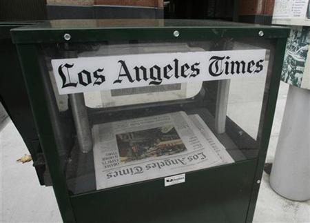 A Los Angeles Times newspaper vending box is shown in front of the Times building in Los Angeles, California December 8, 2008. REUTERS/Fred Prouser