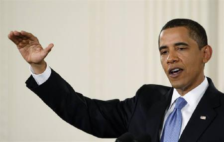 U.S. President Barack Obama gestures during his 100-day anniversary news conference in the White House East Room in Washington April 29, 2009. REUTERS/Jim Young