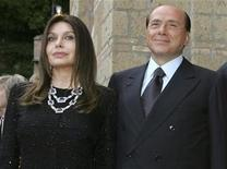 "<p>Italy's Prime Minister Silvio Berlusconi and his wife Veronica Lario (L) pose at Villa Madama in Rome in a June 4, 2004 file photo. Berlusconi's wife wants to file for divorce, Italian media reported May 3, 2009, just days after she publicly criticised his party's selection of young women to run in European elections. ""I have been forced to take this step, I don't want to add anything else,"" La Stampa newspaper quoted Berlusconi's wife Veronica, 52, as saying. La Repubblica daily and ANSA news agency also carried the report. REUTERS/Alessandro Bianchi/Files</p>"