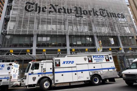 Police vehicles are seen outside the New York Times headquarters building in New York in this October 2008 file photo. The Boston Globe and its biggest union suspended talks on Monday over concessions that parent company The New York Times Co is seeking to keep the 137-year-old newspaper open. REUTERS/Mike Segar