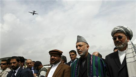Afghan President Hamid Karzai (2nd R) stands between his running mates, former vice-president Mohammad Qasim Fahim (3rd R) and current vice-president Karim Khalili (R), as he speaks to the media after his registration to stand for re-election in Kabul May 4, 2009. Karzai officially registered on Monday to stand for re-election, and named Khalili and Fahim as his two running mates. REUTERS/Ahmad Masood