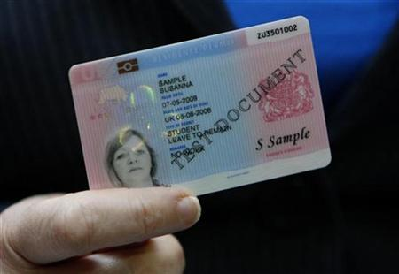 Britain's Home Secretary Jacqui Smith holds a sample British identity card at a news conference in London September 25, 2008. REUTERS/Suzanne Plunkett