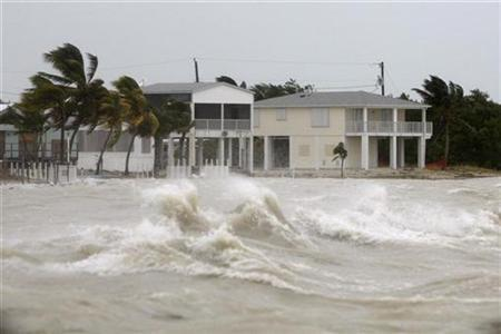 Strong waves crash around coastal houses in Key West, Florida, as Hurricane Ike passes to the south in this file photo from September 9, 2008. REUTERS/Carlos Barria