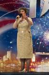 """<p>Scottish singer Susan Boyle is seen performing during a rehearsal of """"Britain's Got Talent"""", in Glasgow, Scotland, in this undated handout photograph received in London on April 20, 2009. REUTERS/Ken McKay/talkbackTHAMES/Handout</p>"""