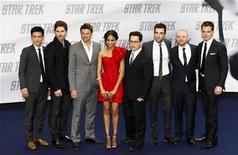 """<p>(L to R) Actors John Cho, Eric Bana, Karl Urban, Zoe Saldana, director J.J. Abrams, Zachary Quinto, Simon Pegg, and Chris Pine pose on the red carpet during the German premiere of the movie """"Star Trek"""" in Berlin, April 16, 2009. REUTERS/Fabrizio Bensch</p>"""