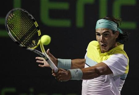 Rafael Nadal of Spain returns a shot to Stanislas Wawrinka of Switzerland during their match at the Sony Ericsson Open tennis tournament in Key Biscayne, Florida March 31, 2009. REUTERS/Carlos Barria