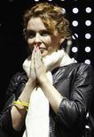 <p>La estrella pop australiana Kylie Minogue se presenta en un concierto benéfico en Melbourne, Australia, 14 mar 2009. A la cantante pop Kylie Minogue no le importa que el éxito del que goza en Reino Unido y Australia la haya eludido en Estados Unidos, pero dice que fantasea con tener una gran carrera cinematográfica. REUTERS/Mick Tsikas/Archivo</p>
