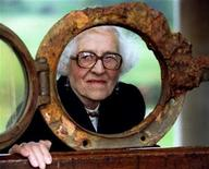 <p>Millvina Dean, the youngest survivor of the Titanic which sank in 1912, peers through a porthole from the sunken liner at the National Maritime Museum in Greenwich, England, in this August 29 1994 file photo.</p>