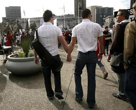 Two men walk hand in hand outside the California Supreme Court during a Proposition 8 demonstration in San Francisco, California in this file photo from March 5, 2009.REUTERS/Robert Galbraith )