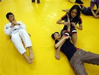 <p>Miss Universe Japan 2009 finalists take part in a Brazilian martial arts Jiu-Jitsu class in Tokyo in this picture taken April 2, 2009. REUTERS/Kim Kyung-Hoon</p>