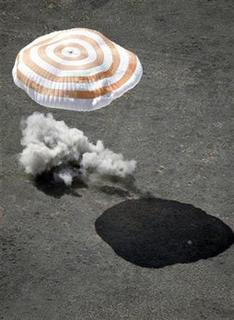 A Russian Soyuz TMA-13 space capsule carrying U.S. billionaire Charles Simonyi and a Russian-American crew hits earth in the Kazakh steppe near Dzhezkazgan, April 8, 2009. REUTERS/Mikhail Metzel/Pool