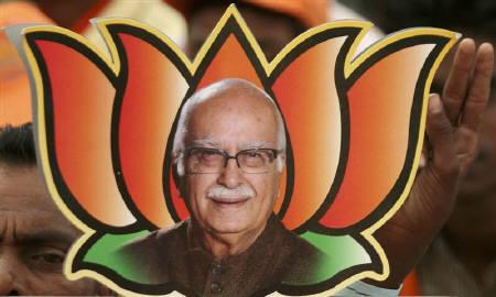 A supporter of India's main opposition Bharatiya Janata Party (BJP) holds a picture of BJP leader and prime ministerial candidate Lal Krishna Advani during an election campaign rally in Balasinor, about 90 km (56 miles) east of Ahmedabad, in this April 14, 2009 file photo. REUTERS/Amit Dave/Files