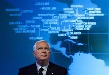 <p>President and chief executive officer of CAE Inc. Robert Brown looks up during their annual general meeting in Montreal, August 13, 2008. REUTERS/Christinne Muschi</p>