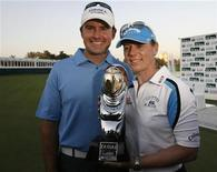 <p>Sweden's Annika Sorenstam with her partner Mike McGee holds her trophy after winning the Golf Dubai Ladies Masters European Tour event December 16, 2007. REUTERS/Ahmed Jadallah</p>