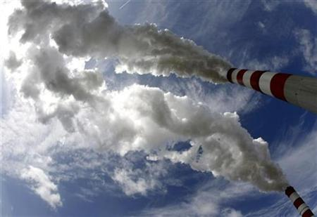 The chimneys of Belchatow Power Station near Belchatow, the Europe's largest thermal power plant emit fumes May 7, 2009. REUTERS/Peter Andrews