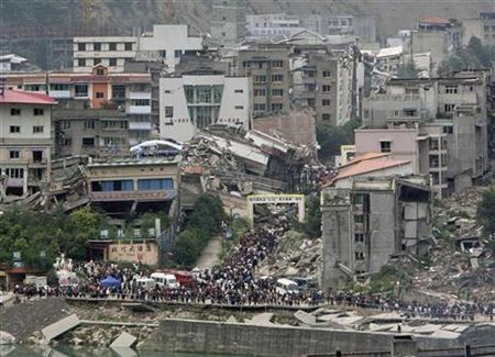 Tens of thousands of people mourn their relatives in the ruins of earthquake-hit Beichuan county, Sichuan Province, May 12, 2009. REUTERS/Jason Lee