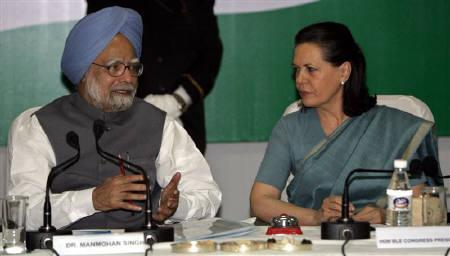 India's Prime Minister Manmohan Singh (L) speaks with India's ruling Congress party Chief Sonia Gandhi during the Congress Working Committee (CWC) meeting in New Delhi May 17, 2009. REUTERS/B Mathur