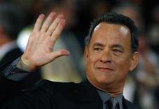 "<p>Actor Tom Hanks waves to photographers during the world premiere of the movie ""Angels & Demons"" at the Auditorium in Rome, May 4, 2009. REUTERS/Alessia Pierdomenico</p>"