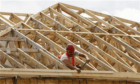 A construction worker swings his hammer at a new home development in Ottawa July 9, 2008. REUTERS/Chris Wattie