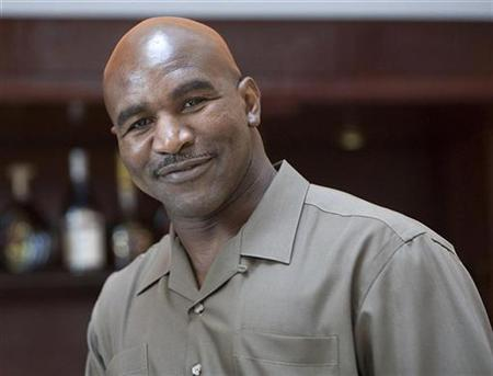 Four-time Heavy Weight World Champion Evander Holyfield of the U.S. poses for a photo after a news conference in Ethiopia's capital Addis Ababa, May 19, 2009. REUTERS/Irada Humbatova