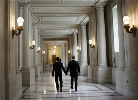 Same-sex couple Stuart Hata (L) and Mark Cadena walk a hallway in City Hall after their wedding ceremony in San Francisco, California November 3, 2008. REUTERS/Robert Galbraith