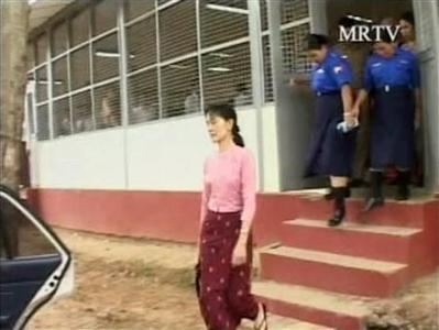 This frame grab shows Myanmar's opposition leader Aung San Suu Kyi (C) being escorted to a car on the third day of her trial at Yangon's Insein Prison, after the junta allowed diplomats and media to observe the trial, May 20, 2009. REUTERS/Reuters TV/MRTV